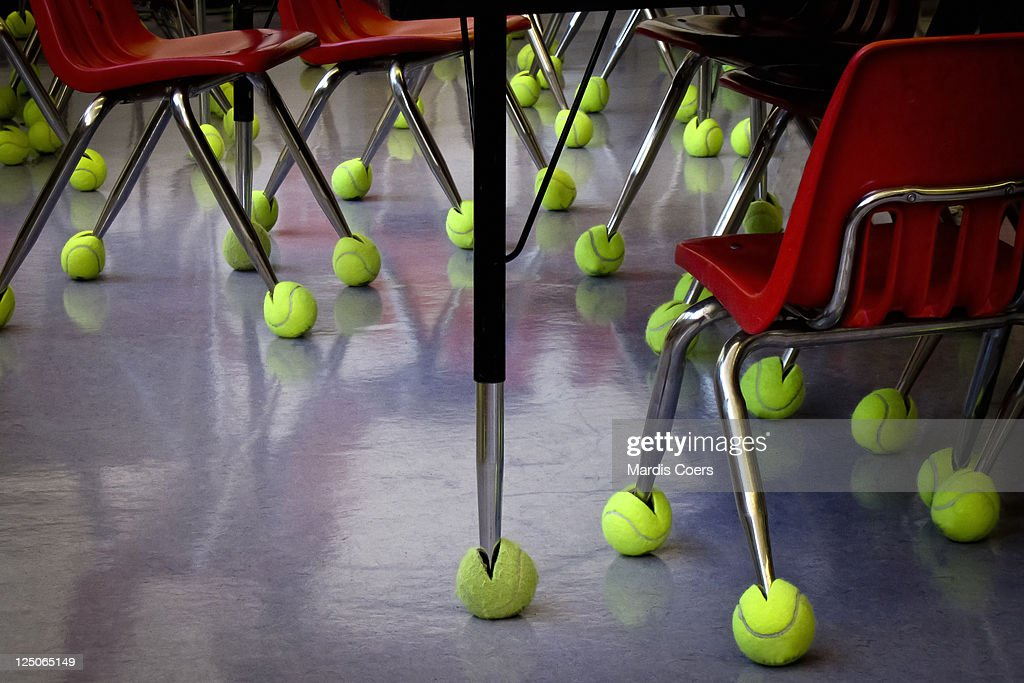 Used Tennis Balls On Classroom Chair And Desk Legs Stock