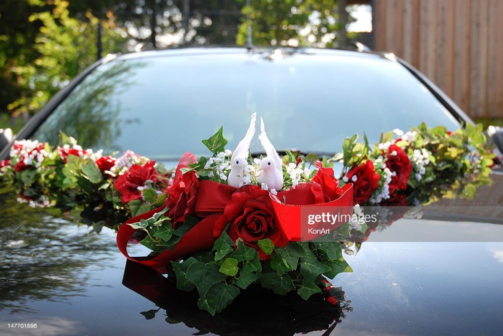 Wedding Car Decoration Of Two White Doves Holding Ring