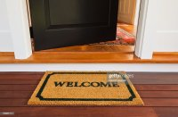 Welcome Mat And Front Door Stock Photo | Getty Images
