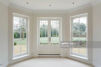White Bay Windows And French Doors Stock Photo