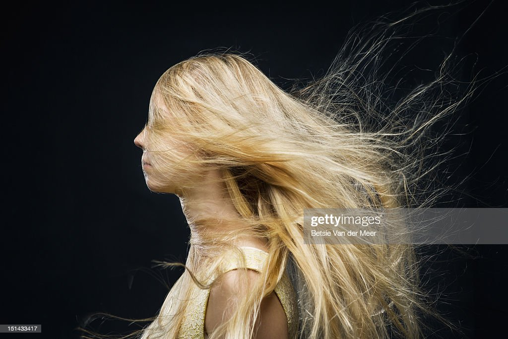 woman covered with hair blowing