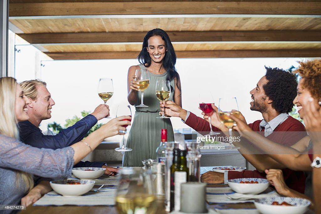 Woman Hosting A Dinner Party Stock Photo Getty Images