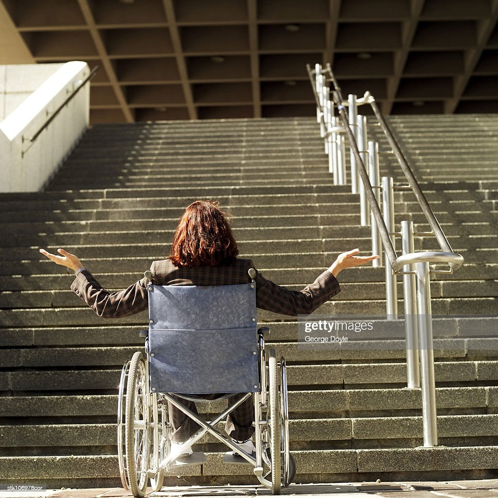 wheelchair up stairs personalized beach chairs for adults woman in a at the bottom of flight