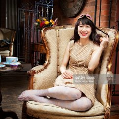 Woman Sitting In Chair Egg Cushion Covers Smiling Stock Photo Getty Images