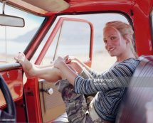 Woman Sitting In Pickup Truck Resting Feet Dashboard