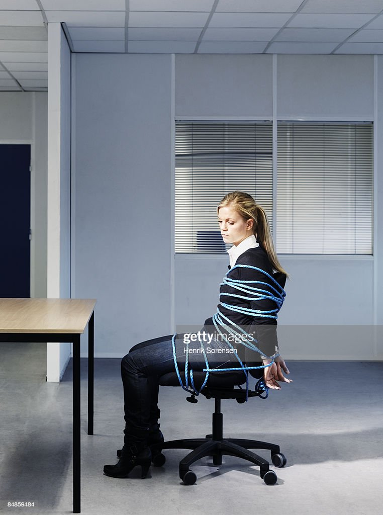Woman Tied To Her Office Chair Stock Photo  Getty Images