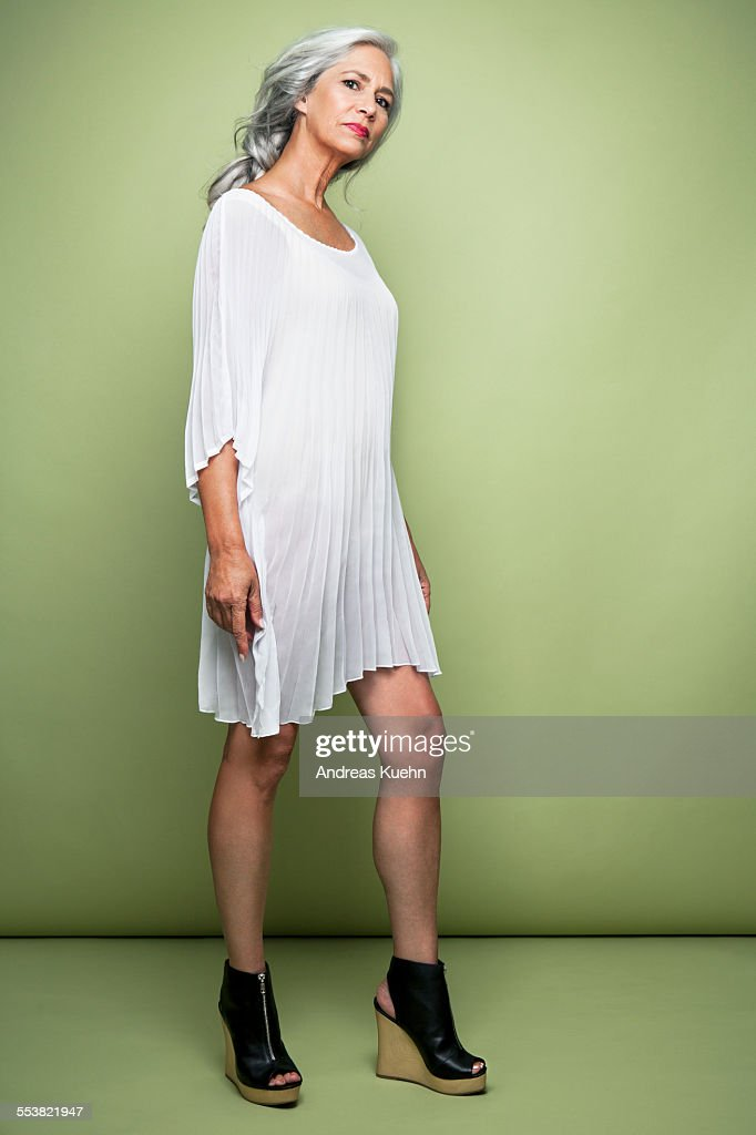 woman with long grey hair in platform