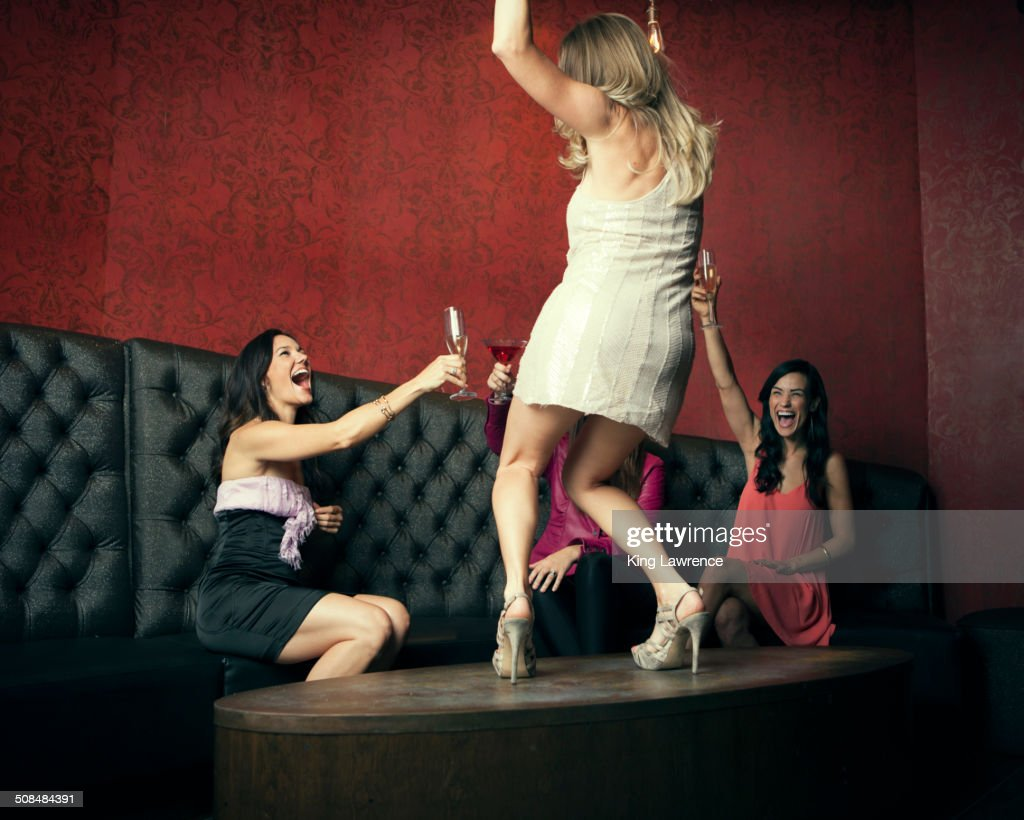 Woman Dancing On Table Stock Photos And Pictures Getty