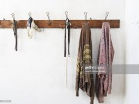 Wooden Coat Rack Wall Hanging With Old Clothes Stock Photo ...