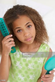 young african american girl brushing