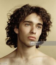 young hispanic man with curly hair