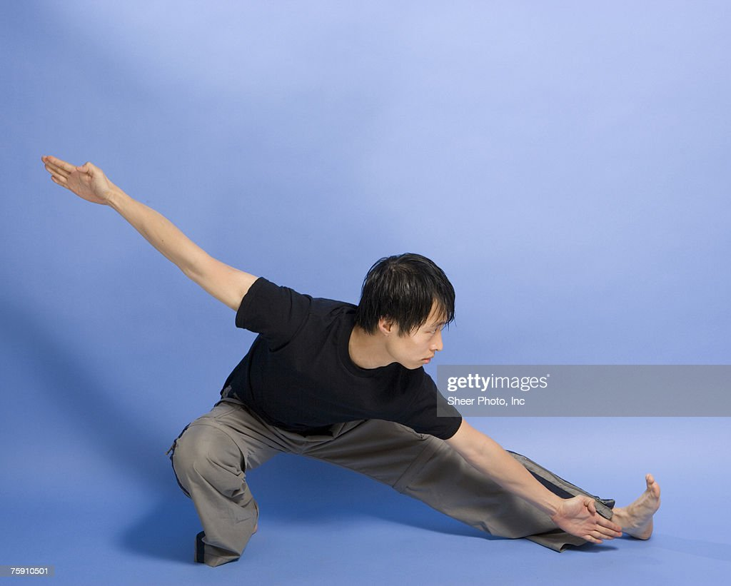 Young Man Performing Tai Chi Stock Photo - Getty Images