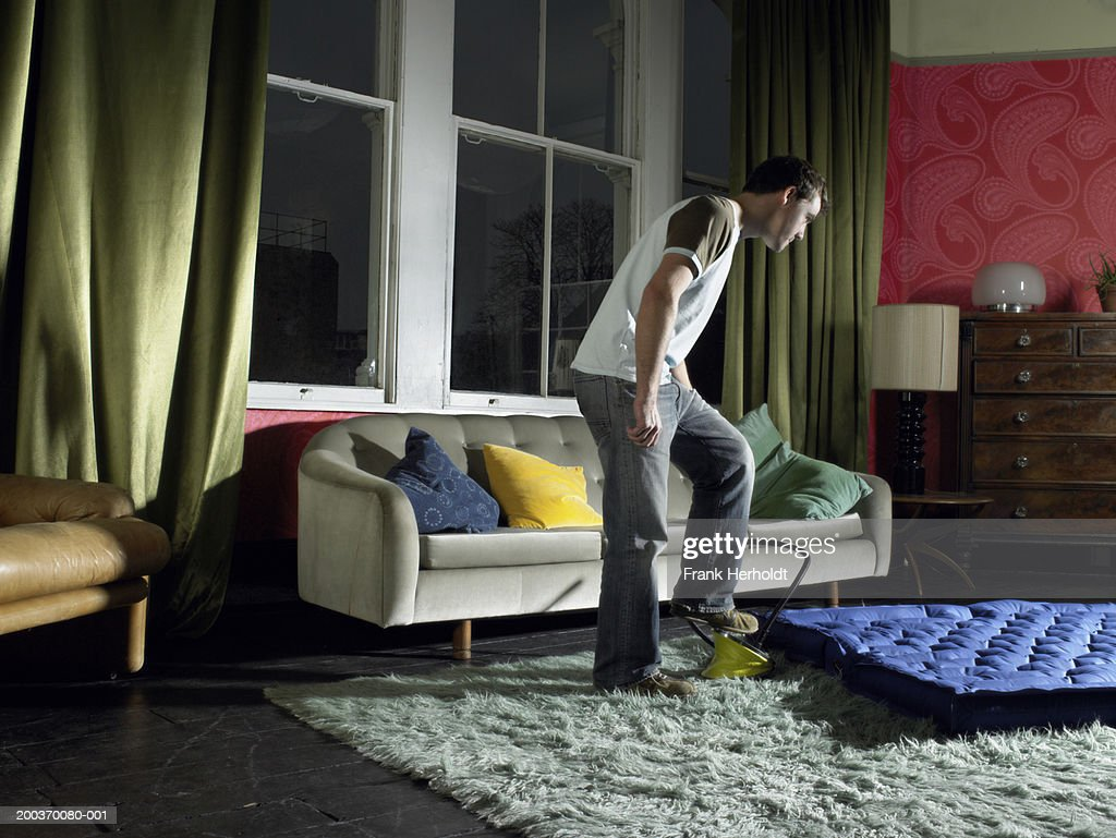 living room mattress ideas navy blue couch young man using foot pump on air in stock photo