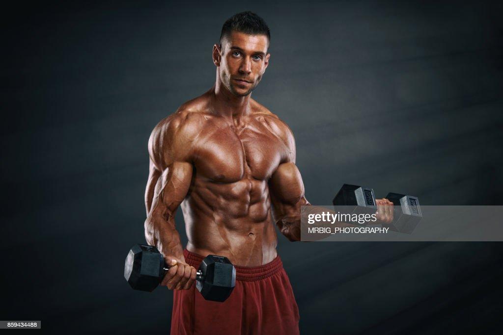 young muscular men flexing