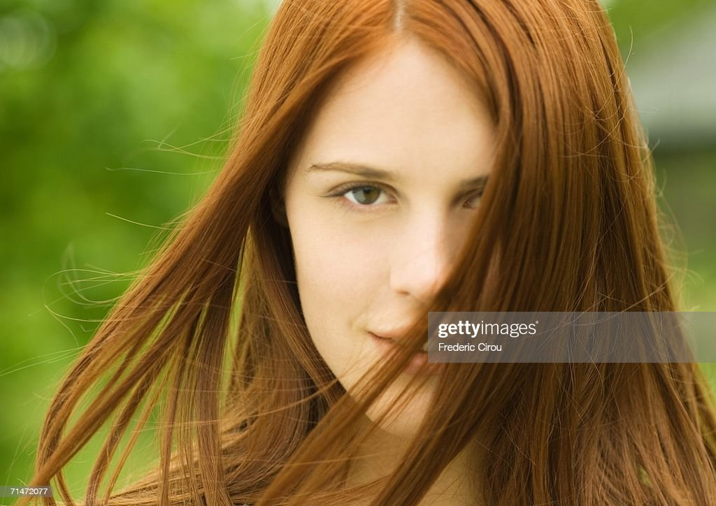 young redhaired woman with hair