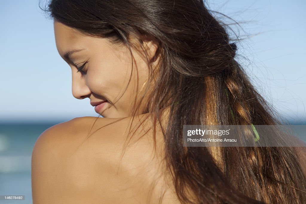 Young Woman Outdoors Over The Shoulder View Stock Photo