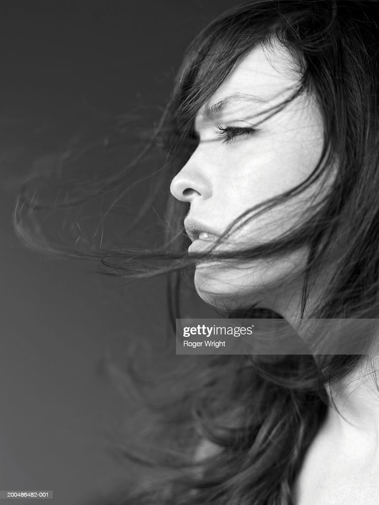 young woman with hair blowing