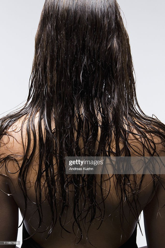 young woman with long wet hair