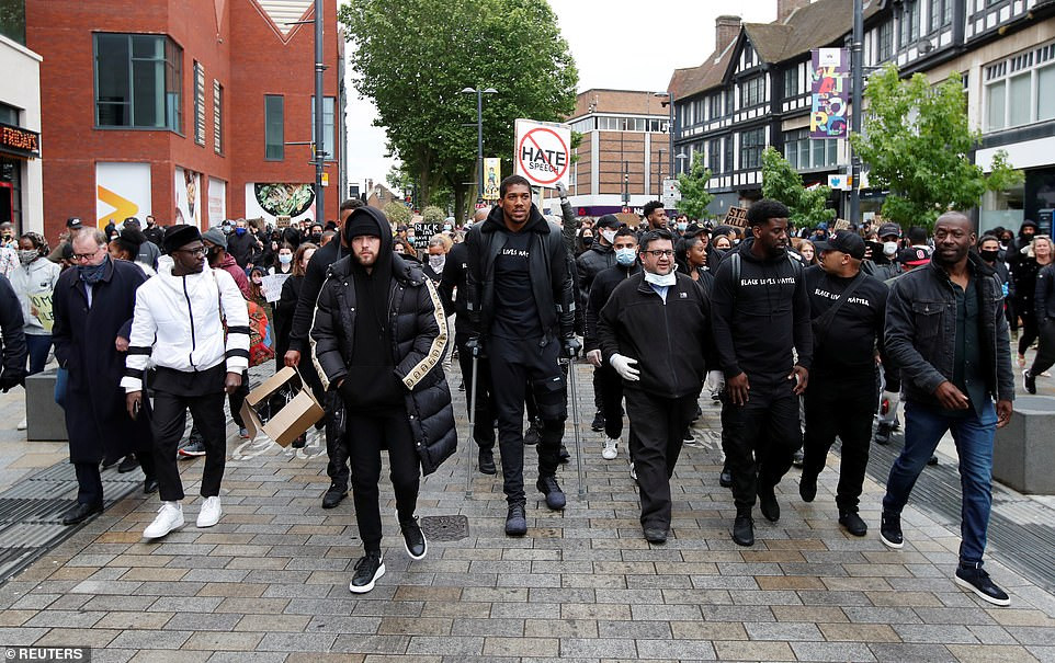 Anthony Joshua wears knee brace to Black Lives Matter protest