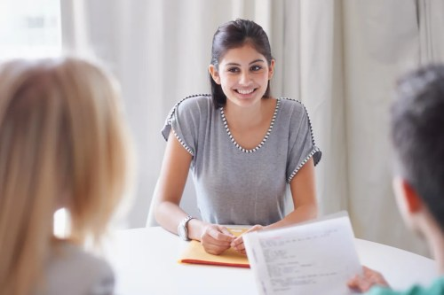 small resolution of a young woman meeting with her financial advisors