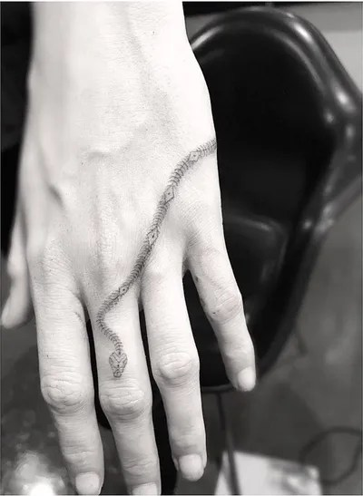 Small Snake Tattoo On Hand