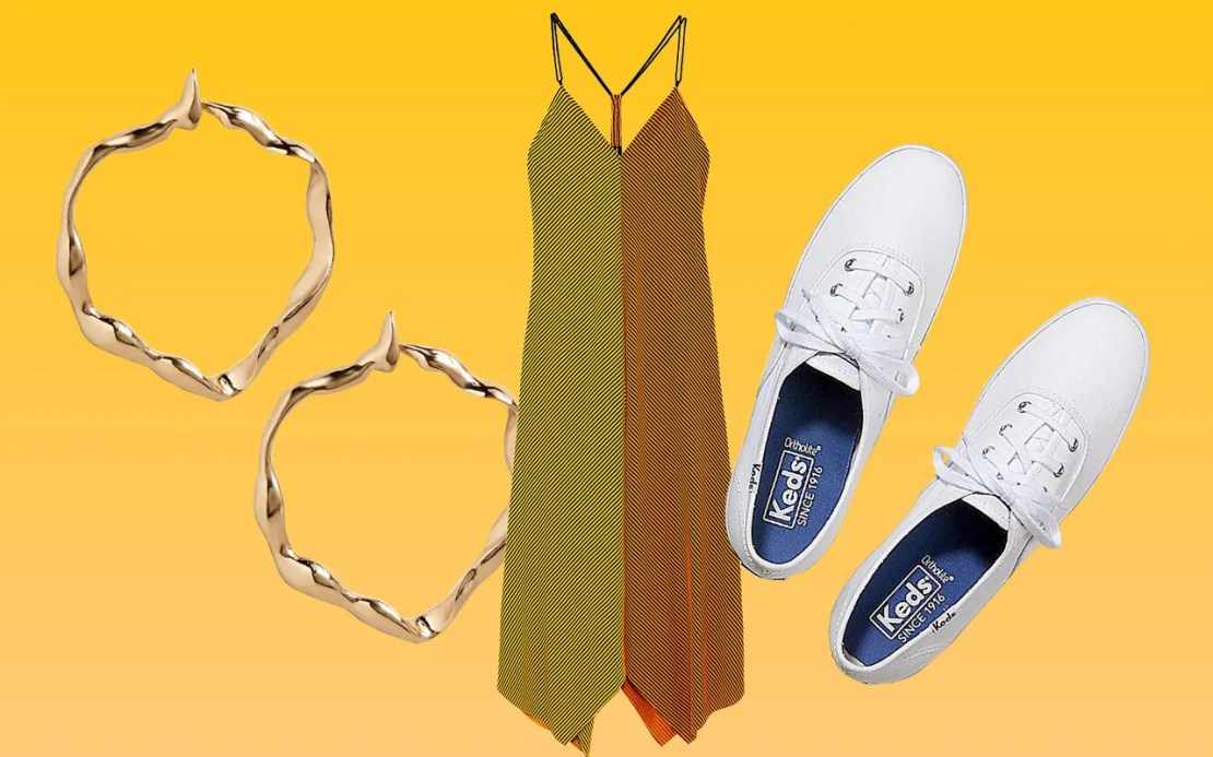 Statement dress + sneakers=a combination that's never not effortless and comfortable. Top it off with standout golden earrings.