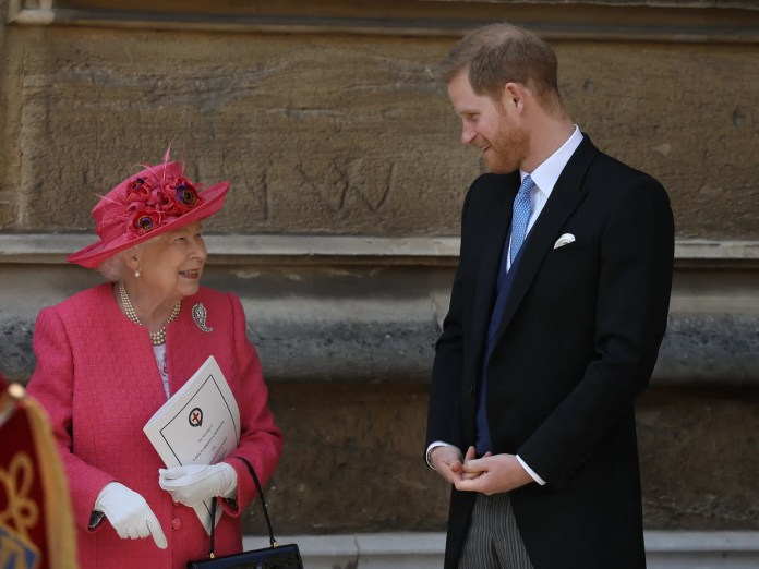 Queen Elizabeth II speaks with Prince Harry Duke of Sussex as they leave after the wedding of Lady Gabriella Windsor