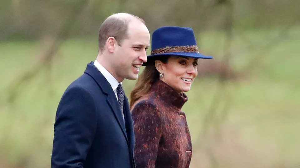 Both royals looked elegant in purple, but the Duchess completed her look with a