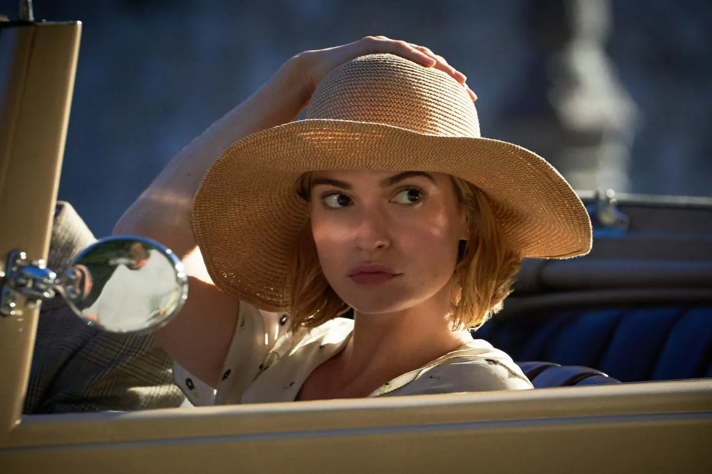 Lily James wearing hat in car for Rebecca