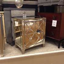 ashley furniture homestore photo of sales floor mirrored end table