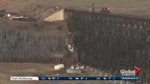 Train cars derail off trestle bridge near Wainwright