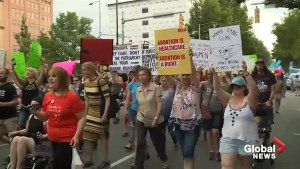 Protesters march in Alabama to denounce abortion ban