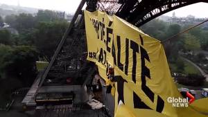 Greenpeace activist dangle from Eiffel Tower during demonstration