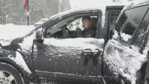 Heavy snowfall creates traffic chaos across Metro Vancouver suburbs.