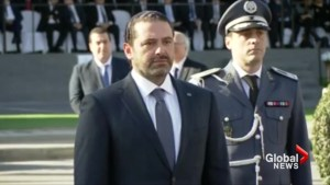Hariri attends parade after returning to Beirut
