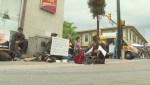 Dozens protest Penticton's plan to ban sitting on downtown sidewalks