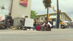 Dozens protest Penticton's plan to ban sitting on downtown sidewalks