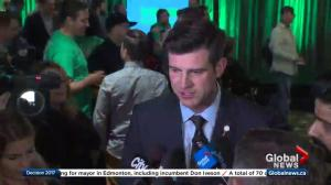Don Iveson speaks to reporters after being re-elected as Edmonton's mayor