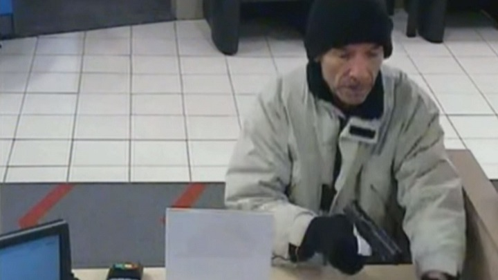 Toronto police searching for alleged bank robber after teller threatened with gun