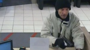 Police searching for alleged bank robber who threatened teller with gun