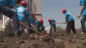 Durham Catholic students lend hand at Habitat for Humanity Durham site