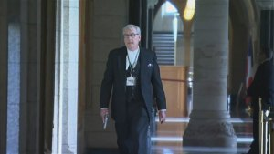 Sergeant-at-Arms Kevin Vickers with gun drawn during Wednesday's Parliament lockdown