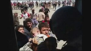 Helicopters taking stranded people from mountain in Iraq