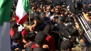 'We don't want them in Tijuana': Protests greet migrant caravan in Mexican city