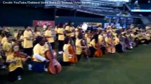 Oakland public schoolers take a knee while playing national anthem at A's game