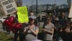 Arrests at duelling rallies over LBGTQ school curriculum