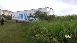Trailer carrying the remains of 157 bodies left in Mexican field
