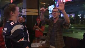 Fans cheer in Massachusetts bars as the New England Patriots win their sixth Super Bowl