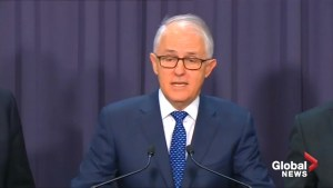 Australian PM walks back climate change commitment