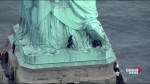 Authorities bring down protester who climbed the base of the Statue of Liberty 